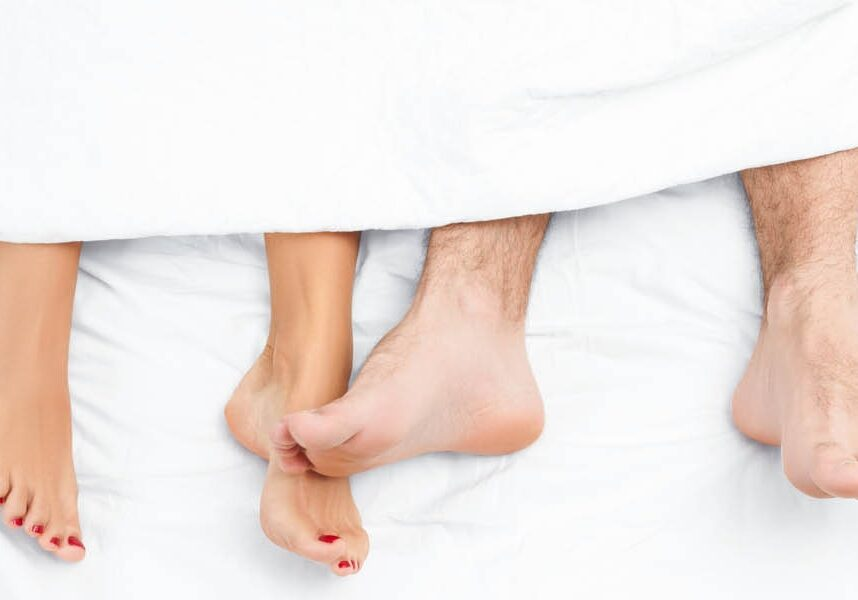 Twopeople's feet in bed