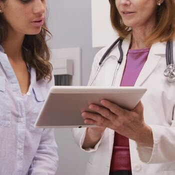 Doctor explaining Vulvodynia treatment to patient